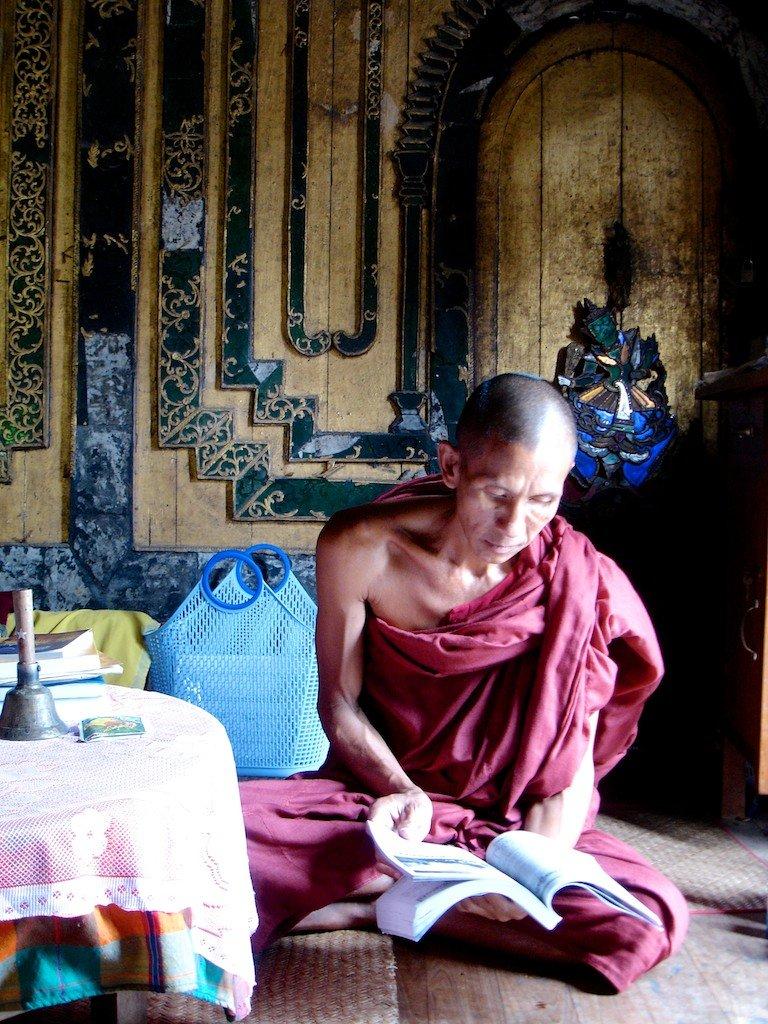 Burma, Inle Lake, Shwe Yan Pye monastery head monk reading