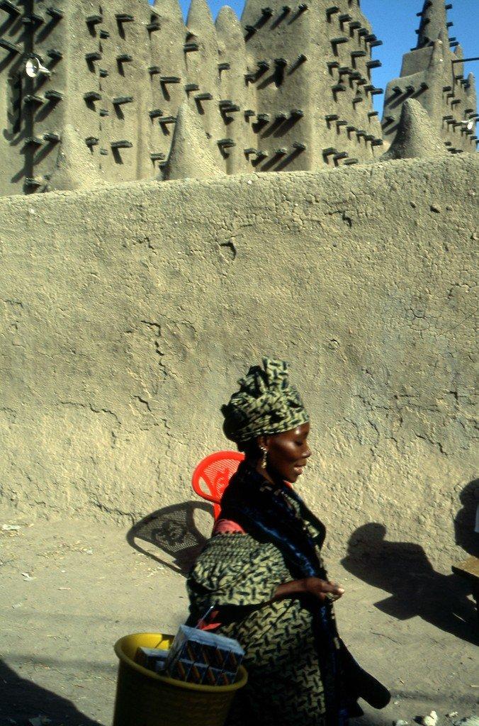 Mali, Djenné mud mosque & woman