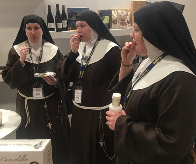 Three nuns at a stand sample cakes