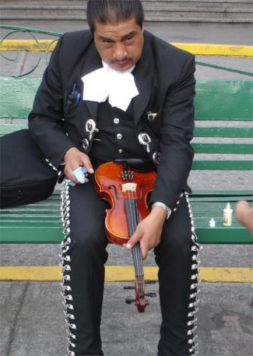 Mariachi cleaning strings, Mexico City