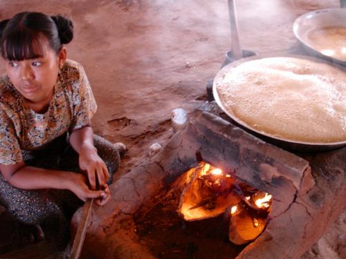 Rd to Mt Popa - girl making jaggery